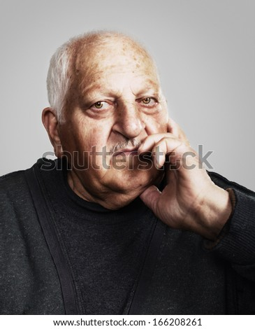 portrait of a sad old man for portrait of a sad old man for 80 years  - stock photo