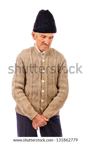 Portrait of a sad  peasant deep in thoughts isolated on white background