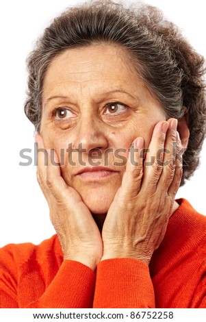 Portrait of a sad senior woman deep in thoughts - stock photo