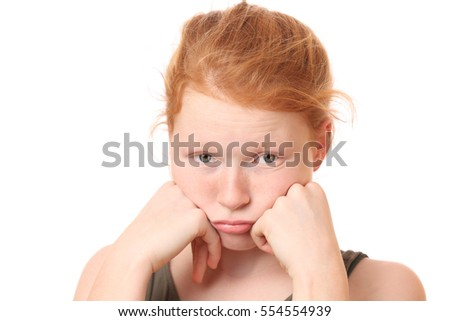 Portrait of a sad teenage girl on white background