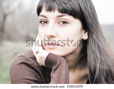 Portrait of a sad woman - stock photo