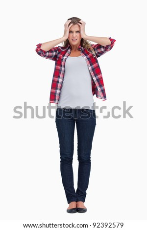 Portrait of a sad woman against a white background - stock photo