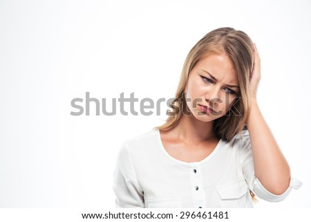 Portrait of a sad woman having headache isolated on a white background