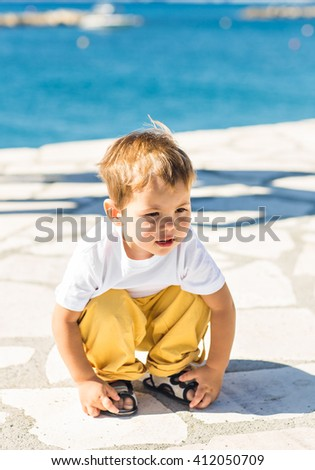 Portrait of a sad young boy thinking on the beach  - stock photo
