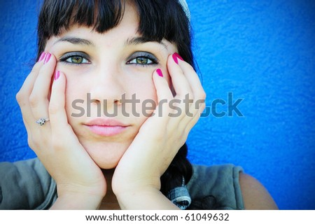 Portrait of a sad young woman - stock photo