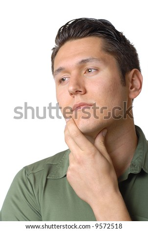 Portrait of a saddened young man in thought - stock photo