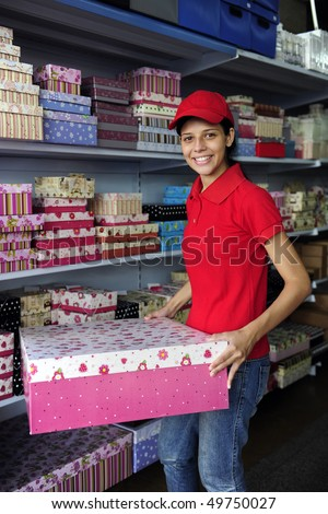 portrait of a salesgirl working  in  gift box store - stock photo