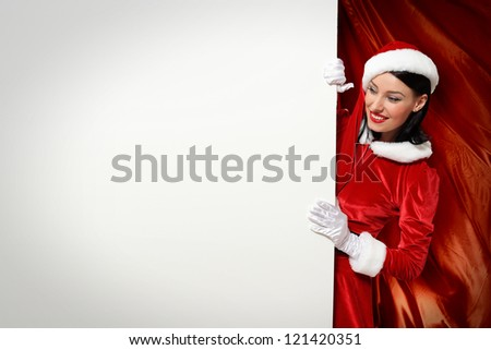 Portrait of a santa girl with a blank banner - stock photo