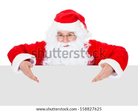Portrait of a santa holding blank placard over white background