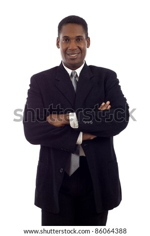 Portrait of a satisfied young African American business man with hands folded  isolated white background - stock photo
