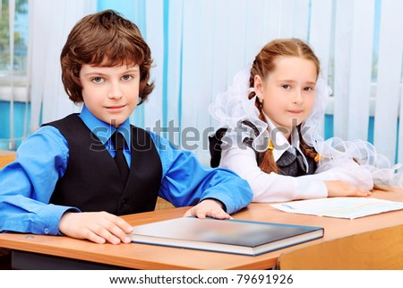 Portrait of a schoolchildren in a classroom. - stock photo