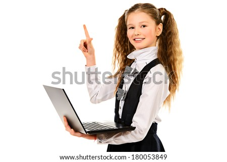 Portrait of a schoolgirl holding a laptop, isolated on white background - stock photo