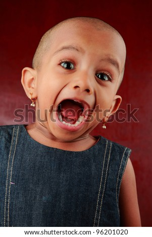 Portrait of a screaming Indian girl child - stock photo