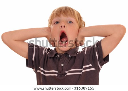 Portrait of a screaming young boy on white background - stock photo