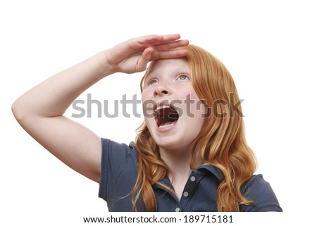 Portrait of a searching young girl on white background - stock photo