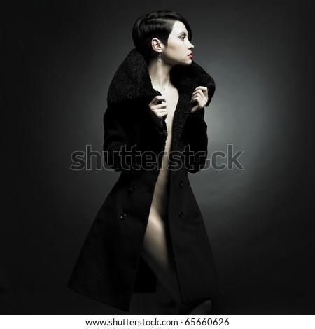 Portrait of a seductive lady in an elegant coat - stock photo