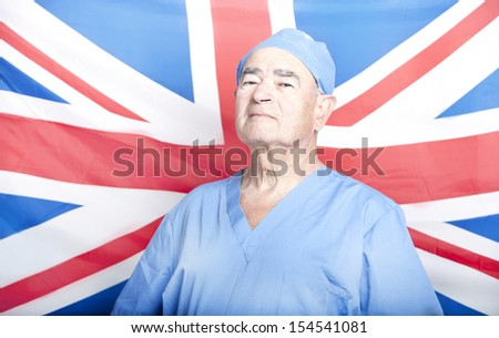 Portrait of a Senior Adult Surgeon in front of a British Flag - stock photo