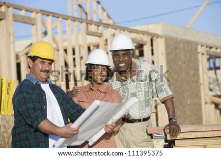 Portrait of a senior african american couple with architect at construction site - stock photo