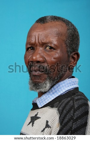 Portrait of a senior African man with a grey beard - stock photo