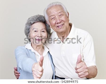 portrait of a senior asian couple. - stock photo
