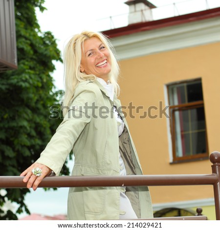 Portrait of a senior business woman outdoors in city - stock photo