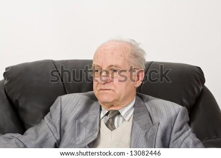 Portrait of a senior businessman against a white background. - stock photo
