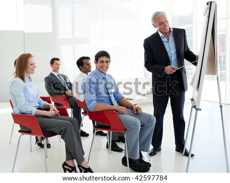 Portrait of a senior businessman giving a conference in the office - stock photo