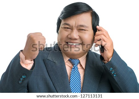 Portrait of a senior businessman having a happy call - stock photo