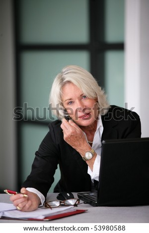 Portrait of a senior businesswoman phoning - stock photo