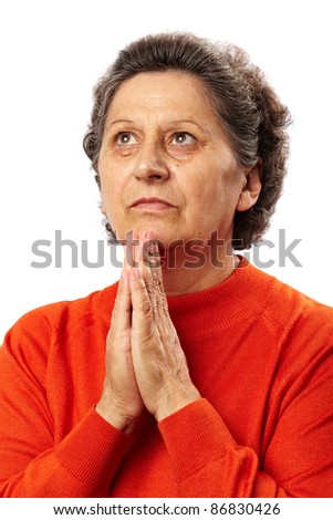 Portrait of a senior caucasian woman praying - stock photo
