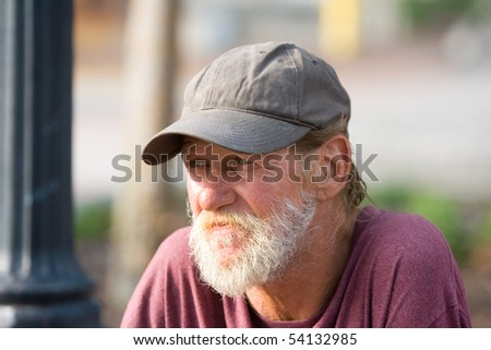 Portrait of a senior citizen man gazing. - stock photo