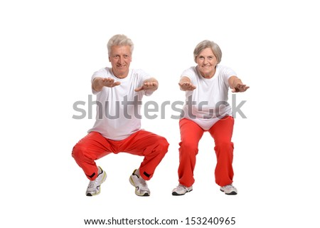 Portrait Of A Senior Couple Exercising On White Background - stock photo