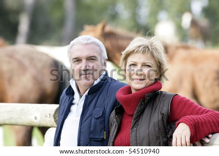 Portrait of a senior couple in the countryside