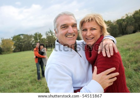 Portrait of a senior couple in the countryside - stock photo