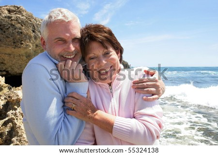 Portrait of a senior couple smiling at the seaside