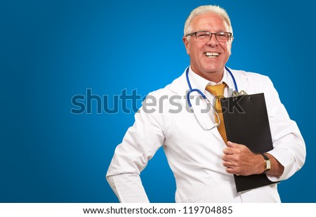 Portrait Of A Senior Doctor On Blue Background - stock photo