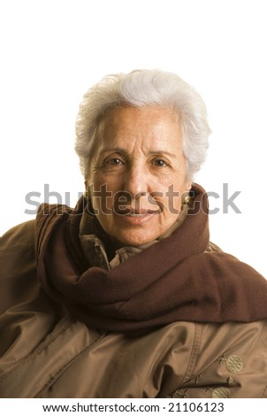 Portrait of a senior lady in winter clothing isolated on white.