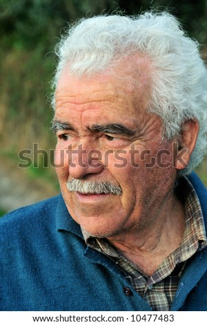 Portrait of a senior male farmer from southern Greece - stock photo