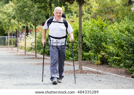 Portrait Of A Senior Male Hiker With Hiking Pole