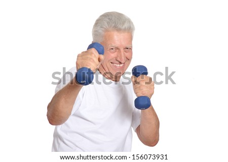Portrait Of A Senior Man Exercising with dumbbells On White Background