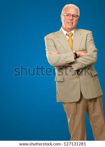 Portrait Of A Senior Man On Blue Background - stock photo