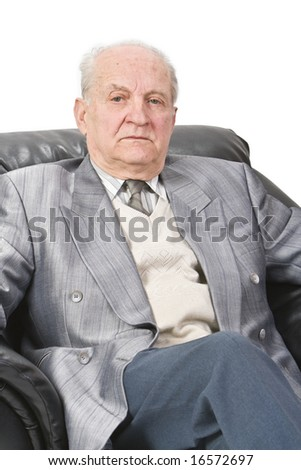 Portrait of a senior man sitting in an armchair. - stock photo