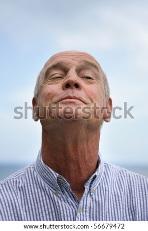 Portrait of a senior man smiling - stock photo