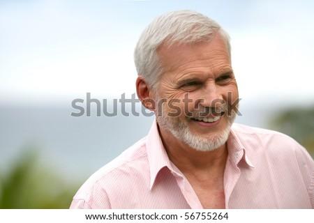Portrait of a senior man smiling - stock photo