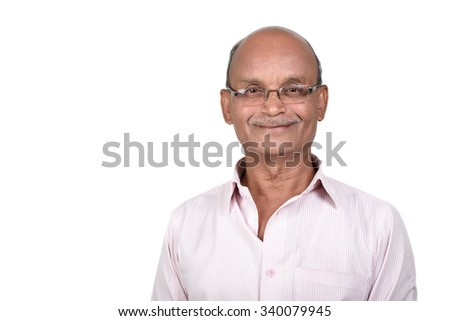 Portrait of a senior man smiling against white background. A senior Indian / Asian man - isolated on white  - stock photo
