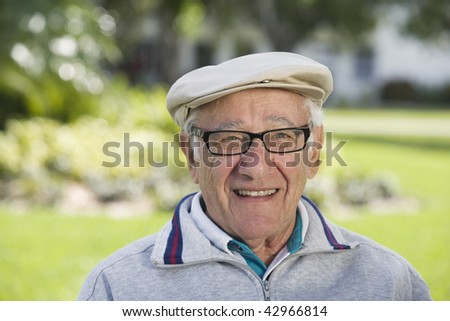 Portrait of a senior man smiling. Horizontally framed shot. - stock photo