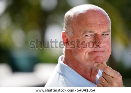 Portrait of a senior man thinking - stock photo