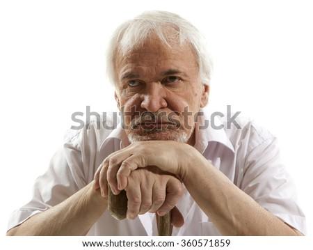 Portrait of a senior man thinking about something - stock photo