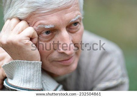 Portrait of a senior man thinking about something outddor - stock photo