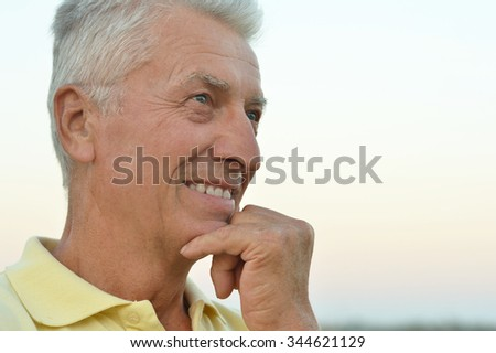 Portrait of a senior man thinking about something outdoor - stock photo
